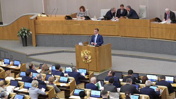 Министр труда и социальной защиты РФ Максим Топилин выступает на пленарном заседании Государственной Думы РФ. 20 марта 2019