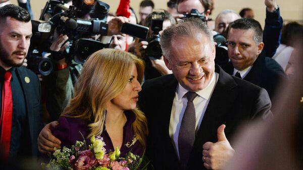 Президент Словакии Андрей Киска поздравляет с победой на выборах кандидата в президенты Зузану Чапутову