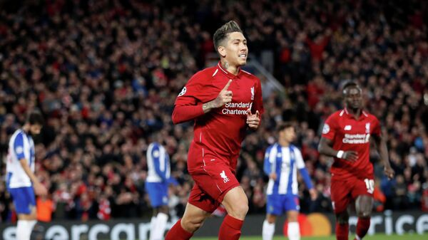 Роберто Фирминьо радуется голу в ворота Порту