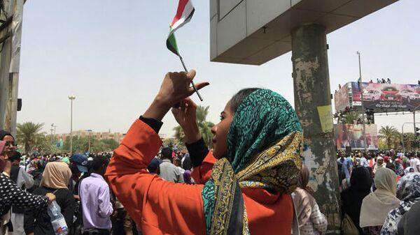 Протестующие против президента страны Омара аль-Башира