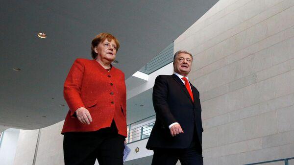 Президент Украины Петр Порошенко и канцлер Германии Ангела Меркель в Берлине. 12 апреля 2019