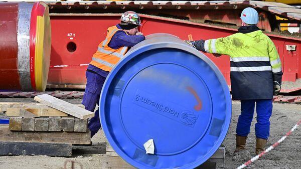 Рабочие на строительной площадке газопровода Nord Stream 2 в немецком Лубмине