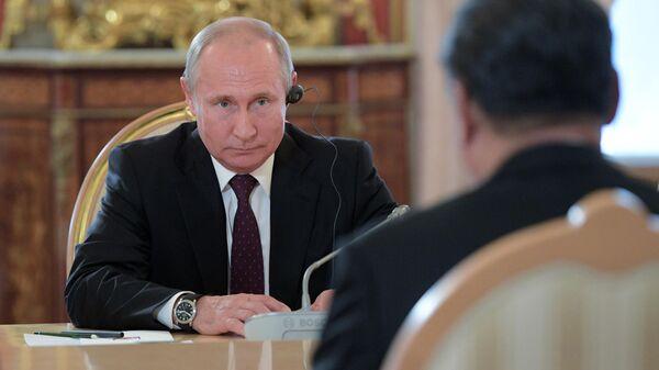 Президент РФ Владимир Путин во время переговоров с председателем КНР Си Цзиньпинем в Кремле. 5 июня 2019