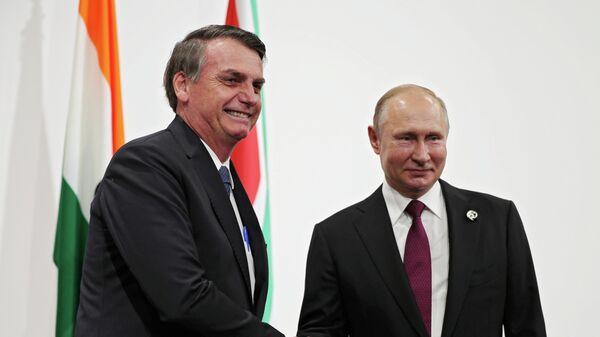 Президент России Владимир Путин и президент Бразилии Жаир Болсонару на саммите БРИКС в Осаке. 28 июня 2019