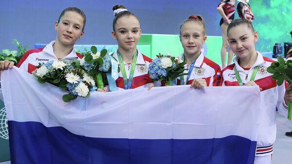 Российские гимнастки после победы на юниорском чемпионате мира