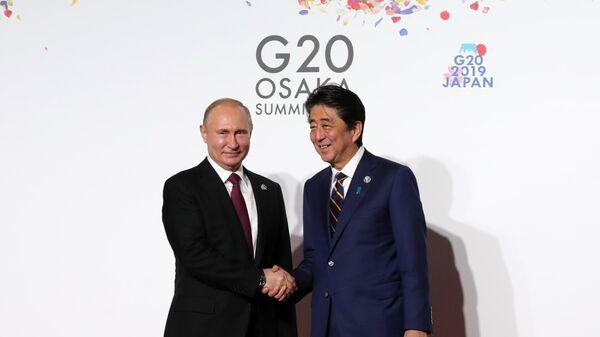 LIVE: Пресс-конференция Владимира Путина и Синдзо Абэ