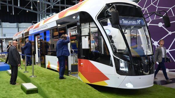 Низкопольный двухсекционный трамвайный вагон 71-923М Богатырь М на стенде компании ПК Транспортные системы на международной промышленной выставке ИННОПРОМ-2019