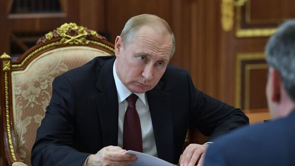 Владимир Путин во время встречи с временно исполняющим обязанности главы Кабардино-Балкарской Республики Казбеком Коковым. 23 июля 2019