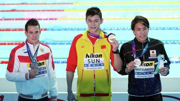 Слева направо: Мартин Малютин (Россия), Сунь Ян (Китай) и Кацухиро Мацумото (Япония)