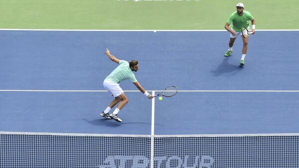 Слева направо: теннисисты Марсель Гранольерс (Испания) и Орасио Себальос (Аргентина)