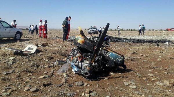 Последствия крушения самолета в провинции Семнан в Иране