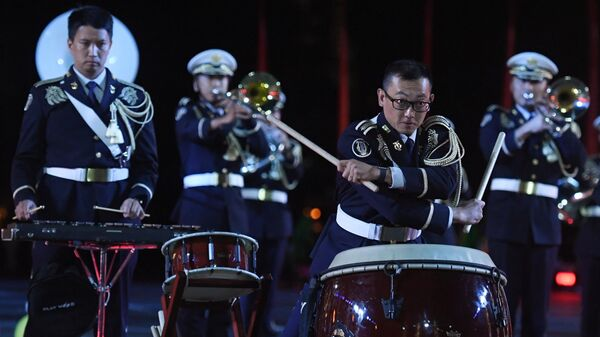 Центральный оркестр Сухопутных сил самообороны Японии на репетиции парада участников Международного военно-музыкального фестиваля Спасская башня на Красной площади в Москве
