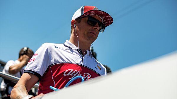 Пилот команды Формулы-1 Альфа Ромео Кими Райкконен (Финляндия)
