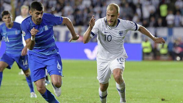 Игровой момент матча Финляндия - Греция