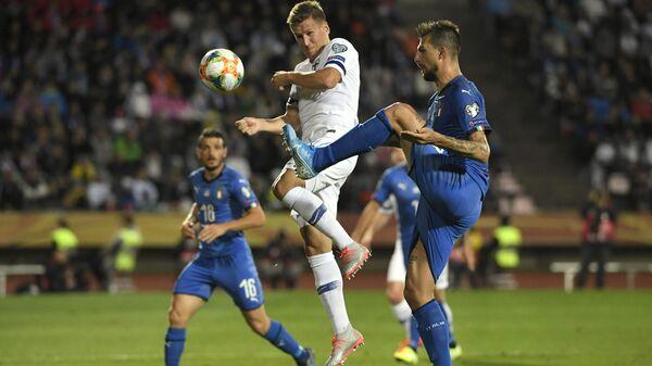 Игровой момент матча Финляндия - Италия