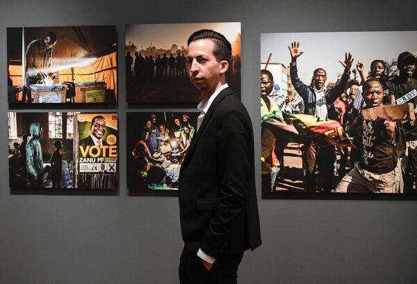 На открытии выставки победителей V Международного конкурса фотожурналистики имени Андрея Стенина