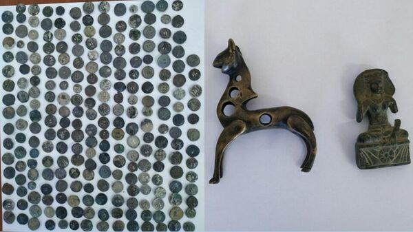 Древние монеты и артефакты III-II веков до нашей эры, изъятые при попытке перевоза их через границу в Сурхандарьинской области Узбекистана
