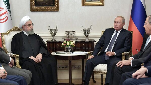 Президент РФ Владимир Путин и президент Ирана Хасан Роухани во время встречи в Анкаре