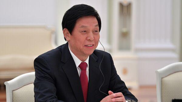 Председатель постоянного комитета Всекитайского собрания народных представителей Ли Чжаньшу во время встречи с президентом РФ Владимиром Путиным