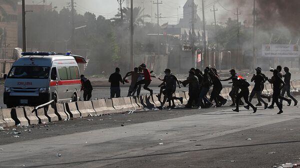 Участники акции протеста в Багдаде, Ирак. 4 октября 2019