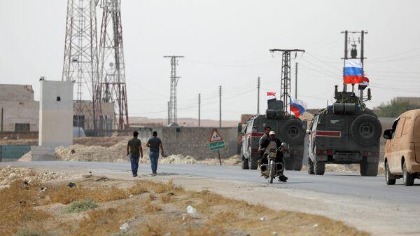 Патруль российской военной полиции в сирийском городе Манбидж. 15 октября 2019