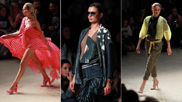 Модели демонстрирует одежду из коллекции Julia Dalakian на площадке Mercedes-Benz Fashion Week Russia в Центральном выставочном зале Манеж в Москве