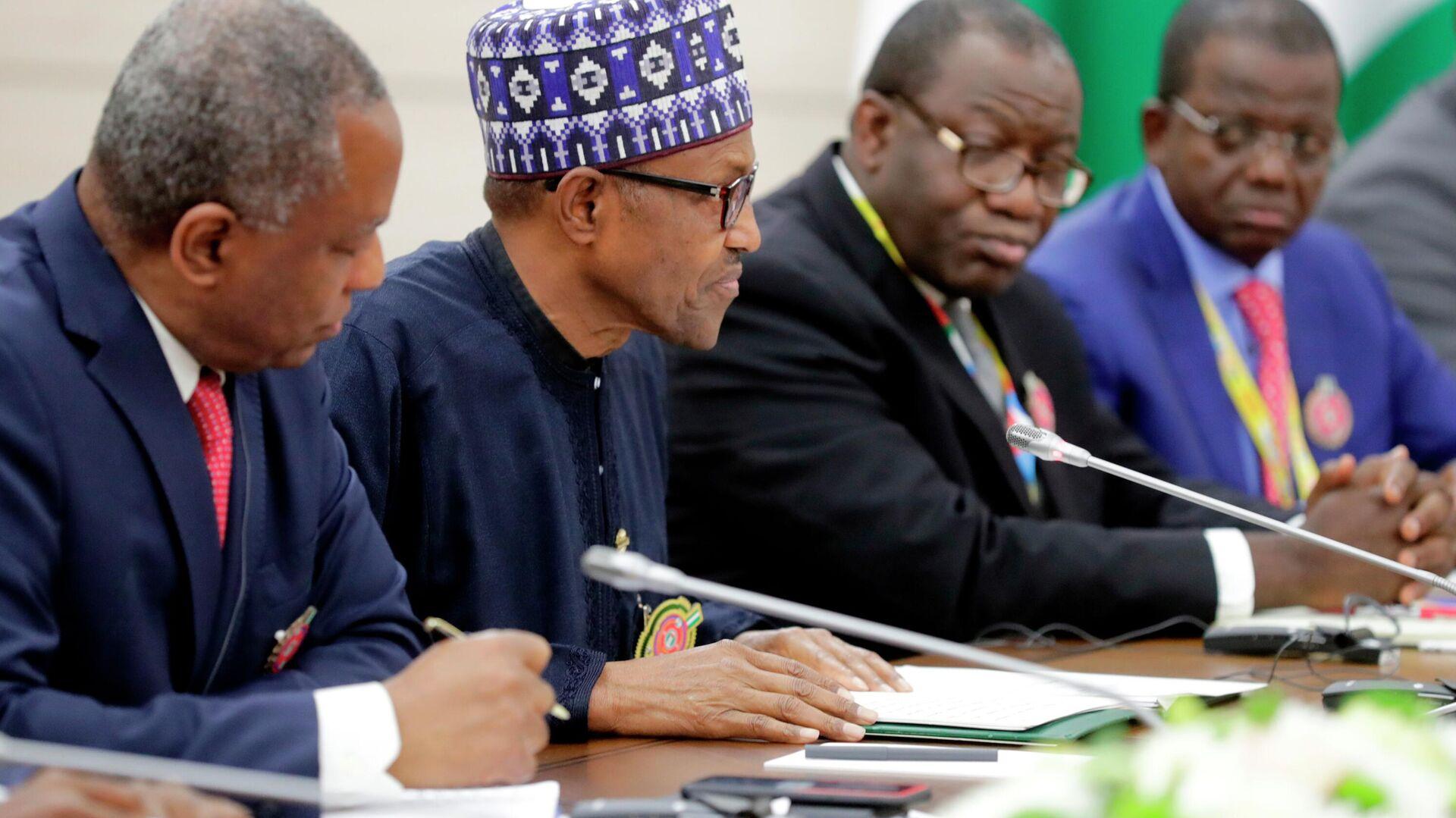 Президент Федеративной Республики Нигерии Мухаммаду Бухари (второй слева) во время встречи с президентом РФ Владимиром Путиным - РИА Новости, 1920, 06.06.2021