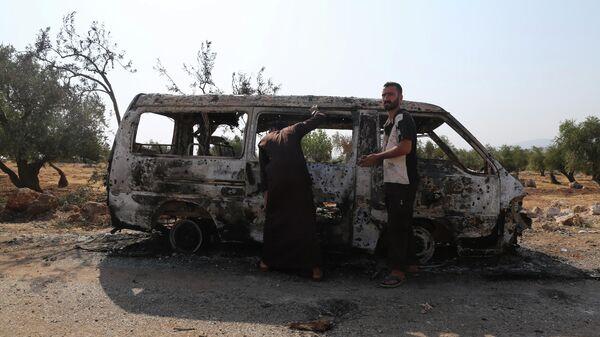 Автомобиль, сгоревший в результате операции вооруженных сил США, направленной против Абу Бакра аль-Багдади, недалеко от деревни Бариша в провинции Идлиб. 27 октября 2019