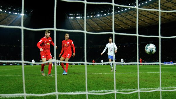 Leipzig's German forward Timo Werner (L) scores during the German first division Bundesliga football match Hertha BSC Berlin v RB Leipzig, at the Olymic Stadium in Berlin on November 9, 2019. (Photo by Odd ANDERSEN / AFP) / RESTRICTIONS: DFL REGULATIONS PROHIBIT ANY USE OF PHOTOGRAPHS AS IMAGE SEQUENCES AND/OR QUASI-VIDEO