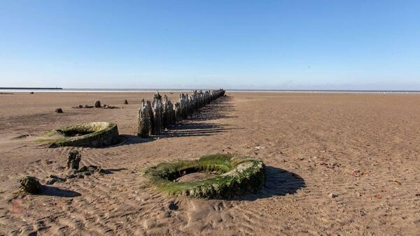 Азовское море  отступило от берега на 100 м