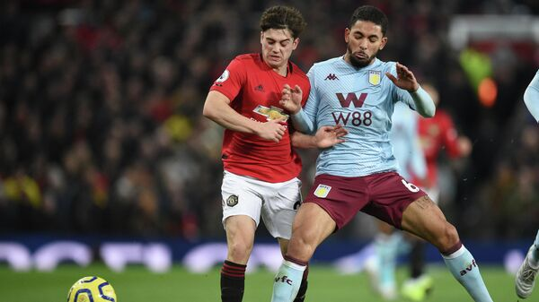 Manchester United's Welsh midfielder Daniel James (L) vies with Aston Villa's Brazilian midfielder Douglas Luiz (R) during the English Premier League football match between Manchester United and Aston Villa at Old Trafford in Manchester, north west England, on December 1, 2019. (Photo by Oli SCARFF / AFP) / RESTRICTED TO EDITORIAL USE. No use with unauthorized audio, video, data, fixture lists, club/league logos or 'live' services. Online in-match use limited to 120 images. An additional 40 images may be used in extra time. No video emulation. Social media in-match use limited to 120 images. An additional 40 images may be used in extra time. No use in betting publications, games or single club/league/player publications. /
