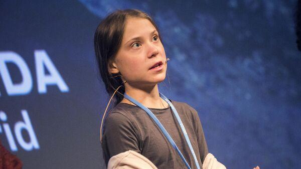 Экоактивистка Грета Тунберг на пресс-конференции перед климатическим протестом Марш за климат в Мадриде, Испания