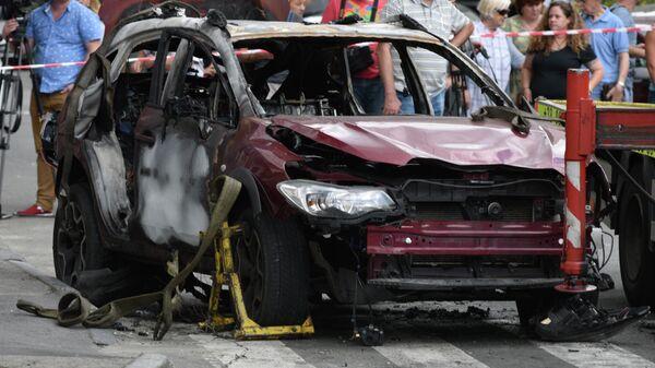 Взорванный автомобиль на перекрестке улиц Богдана Хмельницкого и Ивана Франко в Киеве, в котором погиб журналист Павел Шеремет