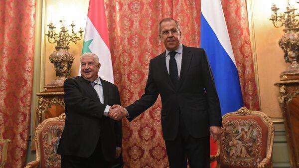 Министр иностранных дел РФ Сергей Лавров и министр иностранных дел Сирии Валид Муаллем