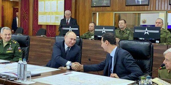 Президент России Владимир Путин и президент Сирийской Арабской Республики Башар Асад во время встречи. 7 января 2020