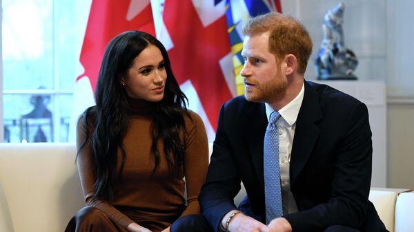 Британский принц Гарри и Меган, герцогиня Сассекская, во время посещения Канадского дома в Лондоне. 7 января 2020
