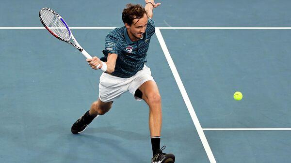 Теннисист Даниил Медведев в матче против Новака Джоковича