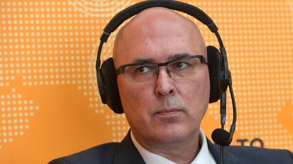 Алексей Ведев во время интервью в радиорубке Sputnik на площадке Х-го Гайдаровского форума. 16 января 2020