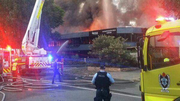 На месте пожара рядом с аэропортом Сиднея, Австралия