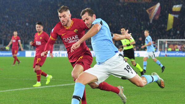Soccer Football - Serie A - AS Roma v Lazio - Stadio Olimpico, Rome, Italy - January 26, 2020  Lazio's Senad Lulic in action with AS Roma's Davide Santon    REUTERS/Jennifer Lorenzini