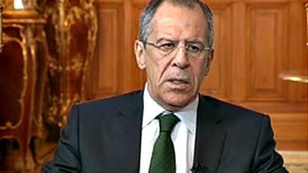 Сергей Лавров во время интервью РИА Новости