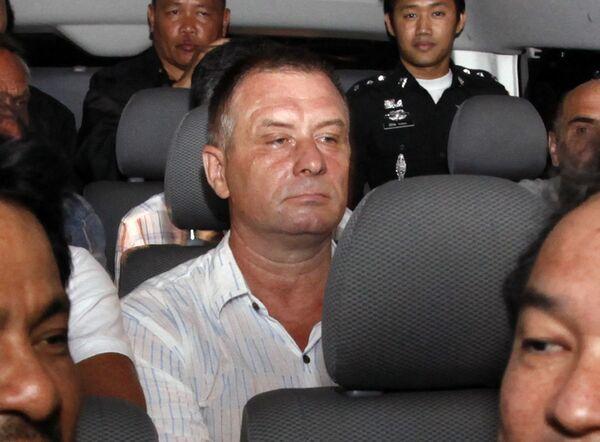 Экипаж самолета Ил-76, задержанного 12 декабря 2009 года в аэропорту Бангкока с грузом оружия из Северной Кореи