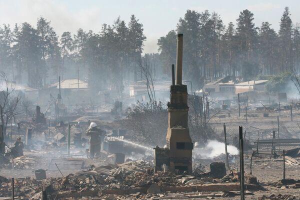 На месте пожаров в селе Николаевка Алтайского края 9 сентября 2010 г.