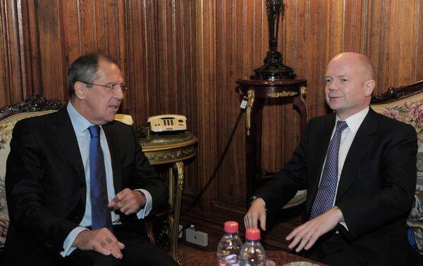 Министр иностранных дел России Сергей Лавров и министр иностранных дел Великобритании Уильям Хейг (слева направо). Архив