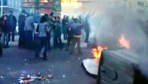 Тысячи иранцев громили Тегеран во время акции в поддержку египтян