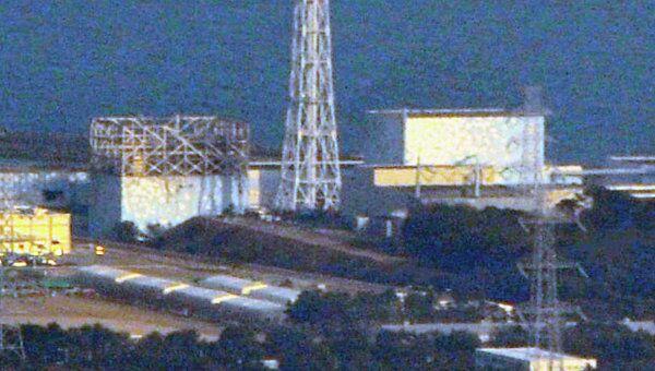 Поврежденная крыша первого реактора АЭС Фукусима-1 в Японии, снимок 13 марта 2011