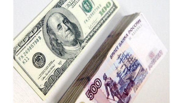 Доллар в пятницу укрепился к рублю еще на 8 копеек - до 30,54 рубля