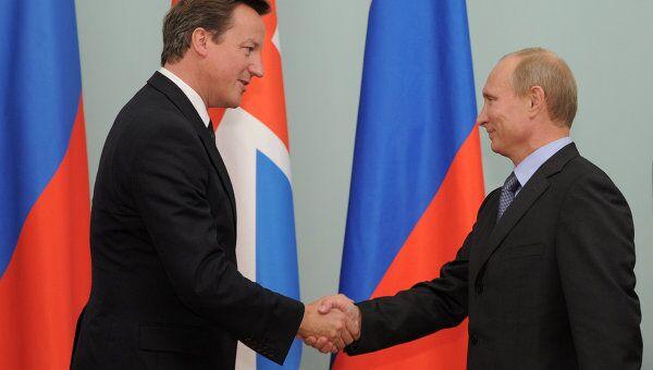 Премьер-министр РФ В.Путин провел встречу с британским премьер-министром Д.Кэмероном