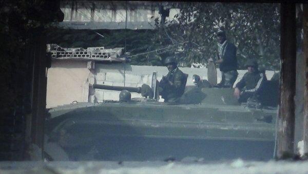 Сирийские солдаты в пригороде Хомса