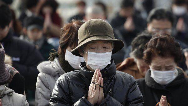 Минута молчания в Японии в память о жертвах землетрясения и цунами
